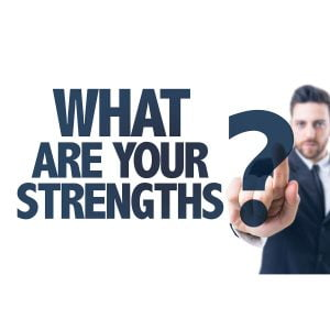 Man pushing question mark asking what are your strengths